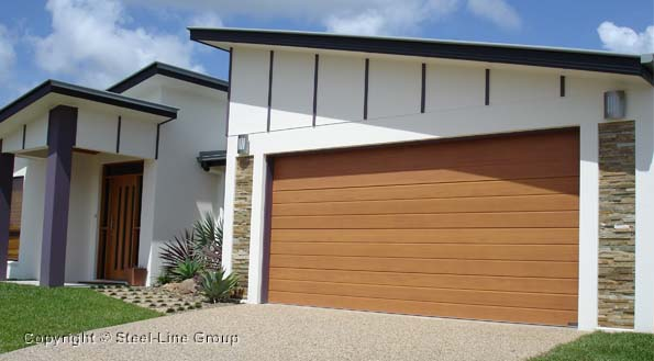 Timber Sectional Garage Door on the front of a house